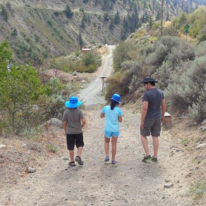 Mylo, Chloe, and Henry Yu walking at Xwisten Fish Rocks in St'at'imc Nation.